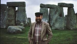 Owen in front of the stones of Stonehenge.